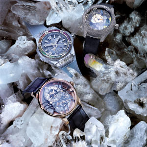 From top: Dior white-gold, yellow-gold, diamond and mother-of-pearl Grand Bal Jardins Imaginaires No 10, £210,000. Hublot white-gold, sapphire, amethyst, ruby, topaz and tsavorite Big Bang One Click Sapphire Rainbow, £61,000. Jaquet Droz rose gold Skelet-One, £26,500