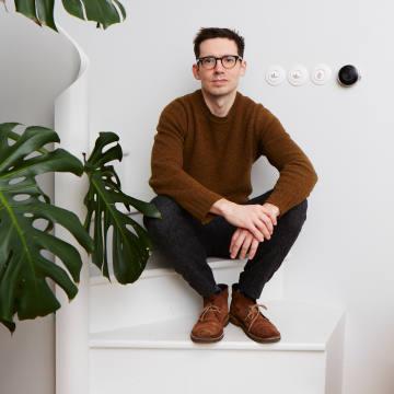 Erdem Moralioglu's trademark black, square-lens frames are by Oliver Peoples