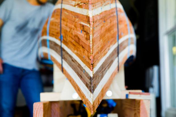 Each handcrafted canoe is built using hundreds of layers of different woods