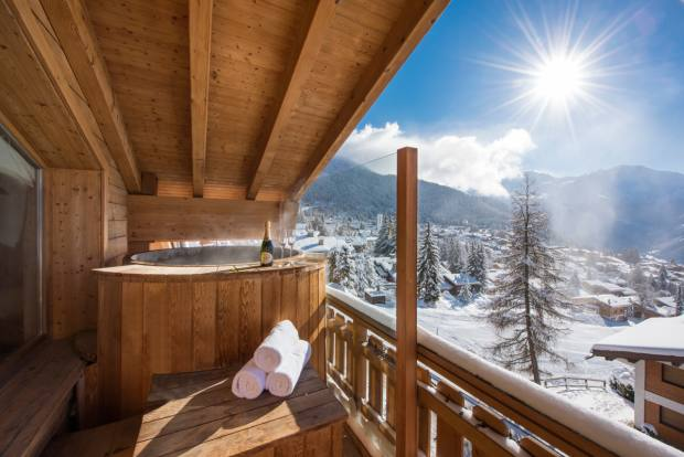 A hot tub on the balcony at No. 14 Verbier, with views of the Grand and Petit Combin