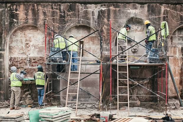 Removing deteriorated masks, basins, pedestals, urns and blocks from the Pumphouse Facade