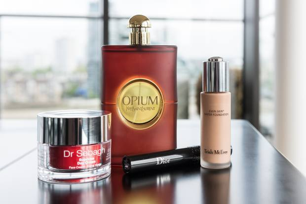 From left: Dr Sebagh Serum Repair, £69 for 20ml. YSL Opium, £44 for 30ml EDT. DiorShow Black Out mascara, £25.50. Trish McEvoy Even Skin Water Foundation, £55