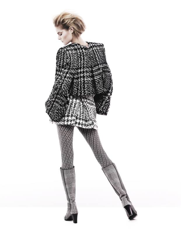 Wool-tweed jacket and wool- tweed miniskirt with hip pads, both price on request, by Thom Browne. Polyester-mix tights, £17.75, by Oroblu from MyTights. Ponyskin-effect boots, £1,650, by Roger Vivier