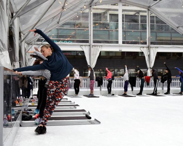 Define London founder Ashley Verma guides a class through a series of poses during a session on the rink
