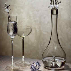 Beau Han Xu handmade crystal champagne and cocktail glasses, £250 each, swizzle stick, £150, and Drop! decanter, £900