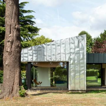 1960s-built Eashing House in Surrey has been reclad with insulating stainless steel, £2.5m, through The Modern House