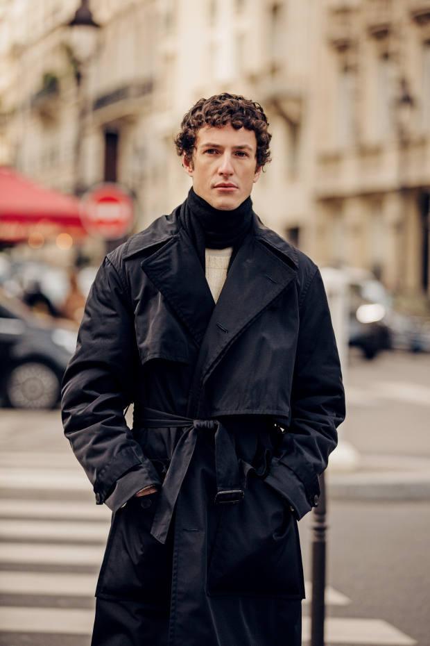 Giovanni Dario Laudicina wears a trench coat by Dries Van Noten
