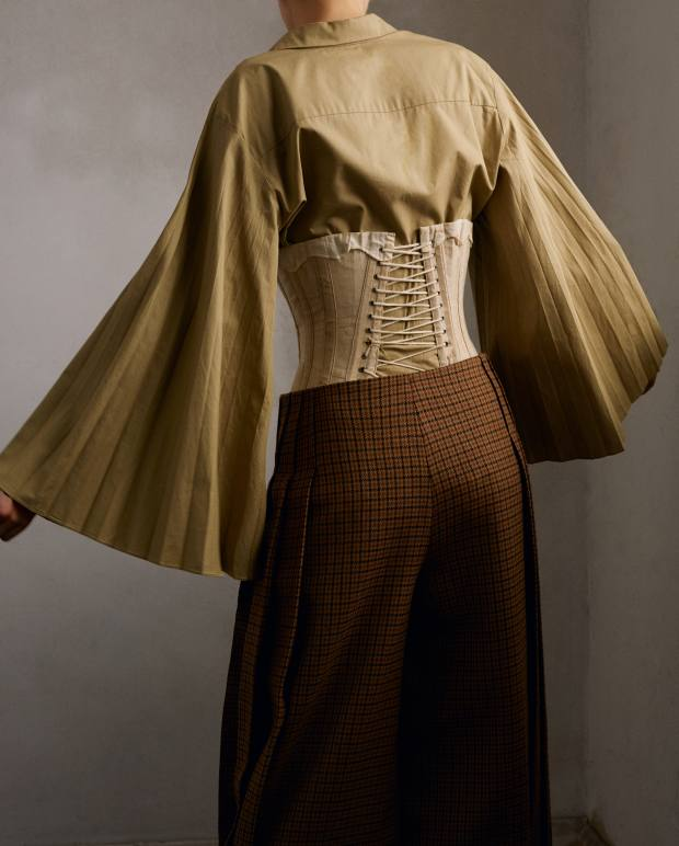Christopher Kane cotton poplin shirt, £475. Mulberry wool Harriet trousers, £820. Vintage corset, stylist's own
