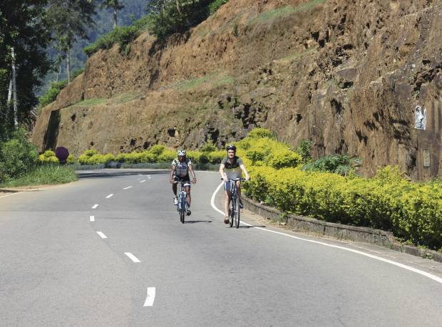 Charlie Norton and guide Anura Kumarasinghe start the gruelling ascent from Kandy to Nuwara Eliya