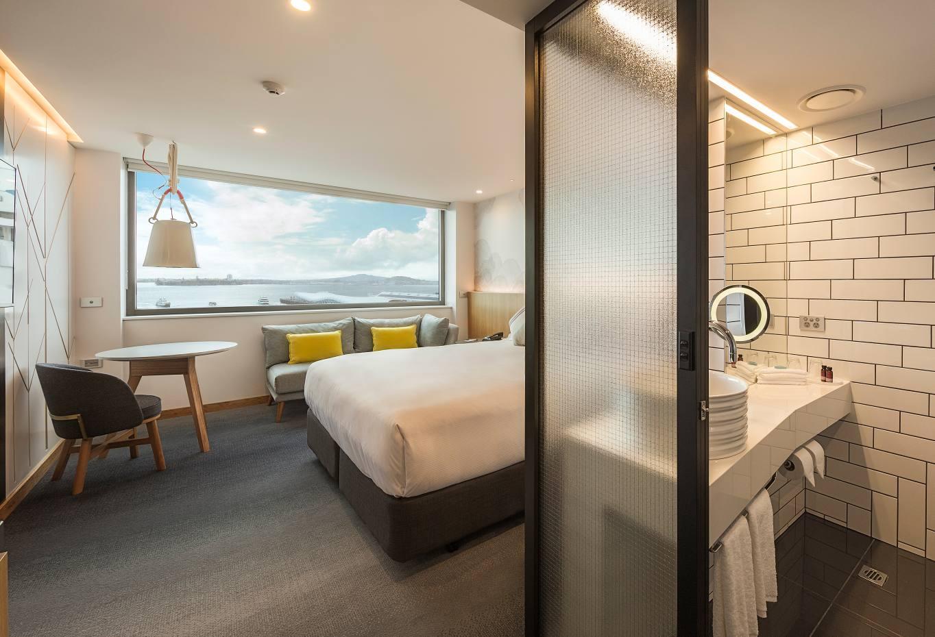 Guest rooms at M Social Auckland have wall-to-wall windows with spectacular views of Auckland Harbour