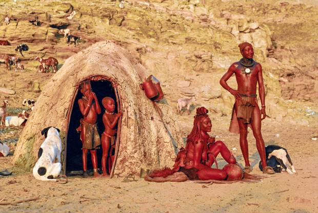 A family from Namibia's Himba tribe in a dwelling made of branches and mud, 1994