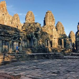 The author explores the maze-like Bayon temple at the heart of Angkor Thom, 7km into his 40km Sunday run