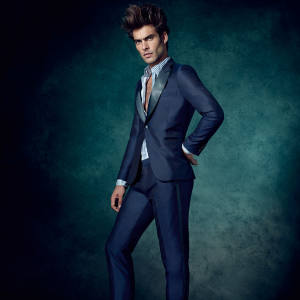 Paul Smith bespoke wool tuxedo, from £5,000, and cotton shirt, £135. John Lobb patent-leather slip-on shoes, £585
