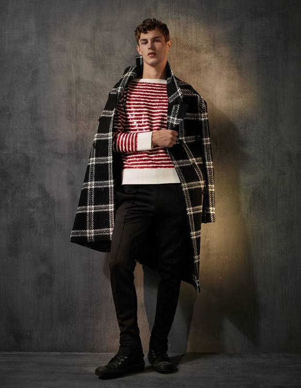Burberry merino wool/cashmere coat, £1,895, cashmere and sequin jumper, price on request, cotton jersey tracksuit trousers, £295, and leather boots, £395