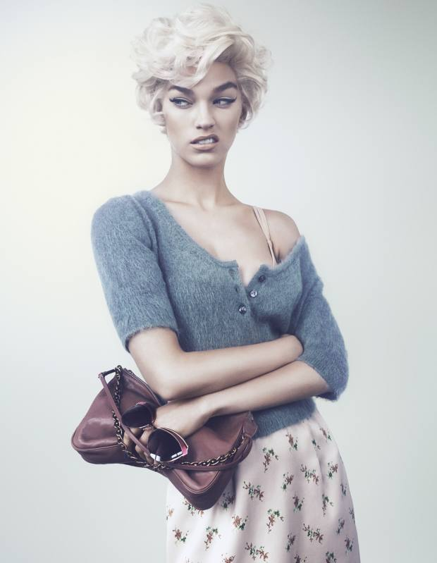 Mohair/wool sweater, £525, silk and lace skirt, £1,130, and leather handbag, £1,420, all by Louis Vuitton. Nylon/spandex bra, £80, by dMondaine. Sunglasses, £320, by Dior
