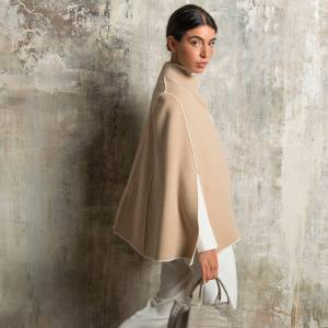 Cashmere cape, €1,580; also available in taupe or navy