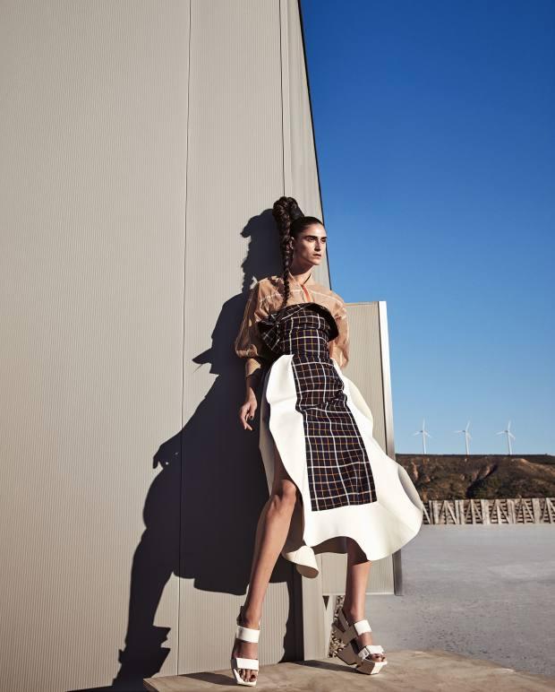 Awake cotton-mix twill and polyurethane dress, £945. DKNY parachute nylon jacket, £898. Issey Miyake leather sandals, £350