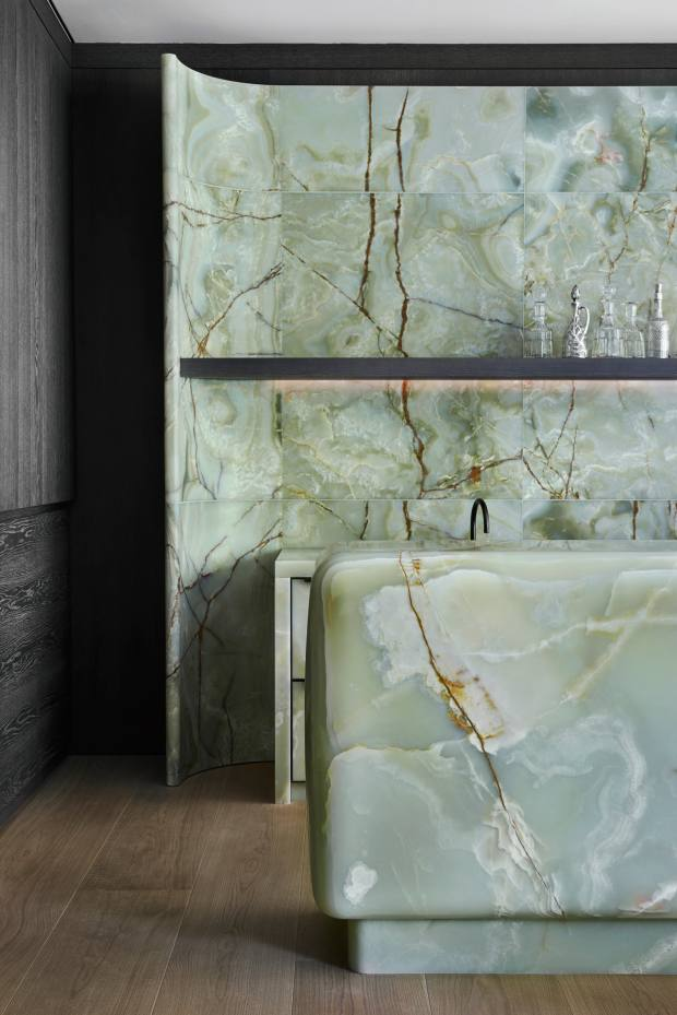 The Munich home's family espresso bar is also carved from green onyx