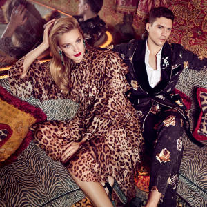 Anna wears Dolce & Gabbana chiffon coat, €3,500, and matching dress, €2,950. Gina satin, mink and Swarovski crystal platforms, £1,255. Graff white gold, diamond and Colombian emerald earrings, white gold and diamond ring (right hand), and platinum, gold and yellow diamond ring (left hand), all price on request. James wears Dolce & Gabbana velvet and cotton suit, £2,650, and cotton shirt with mother-of‑pearl buttons, £485. Graff white gold and diamond gecko brooch, price on request