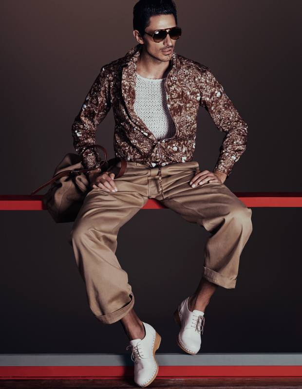 E Tautz cotton jacket, £485, and cotton trousers, £189. Gucci knitted-silk tank top, £350. Maison Martin Margiela distressed-leather clogs, about £611. Alexander McQueen sunglasses, £265. Aspinal nubuck tote, £295