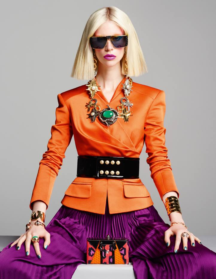 Balmain crepe satin jacket, £3,050, crepe satin trousers, £3,050, and patent leather belt, price on request. Helena Rubinstein vintage sunglasses, £350, from The Eye Company. Fausto Puglisi brass earrings and resin necklace, both price on request. Tiffany & Co gold Atlas cuff (model's right arm top), £9,875. Cartier rose gold, diamond, opal, amethyst, smoked quartz and haematite Nouvelle Vague bangle (right arm bottom), £42,200, gold and chrysoprase ring (right hand), £23,800, and gold, diamond and lacquer ring (left hand), £42,800.  Aurélie Bidermann gold plated Marella cuff (left arm top), £485. Bulgari gold, mother of pearl and antique silver coin Monete Antiche bracelet (left arm bottom), £9,750. Paula Cademartori snakeskin clutch, £1,355