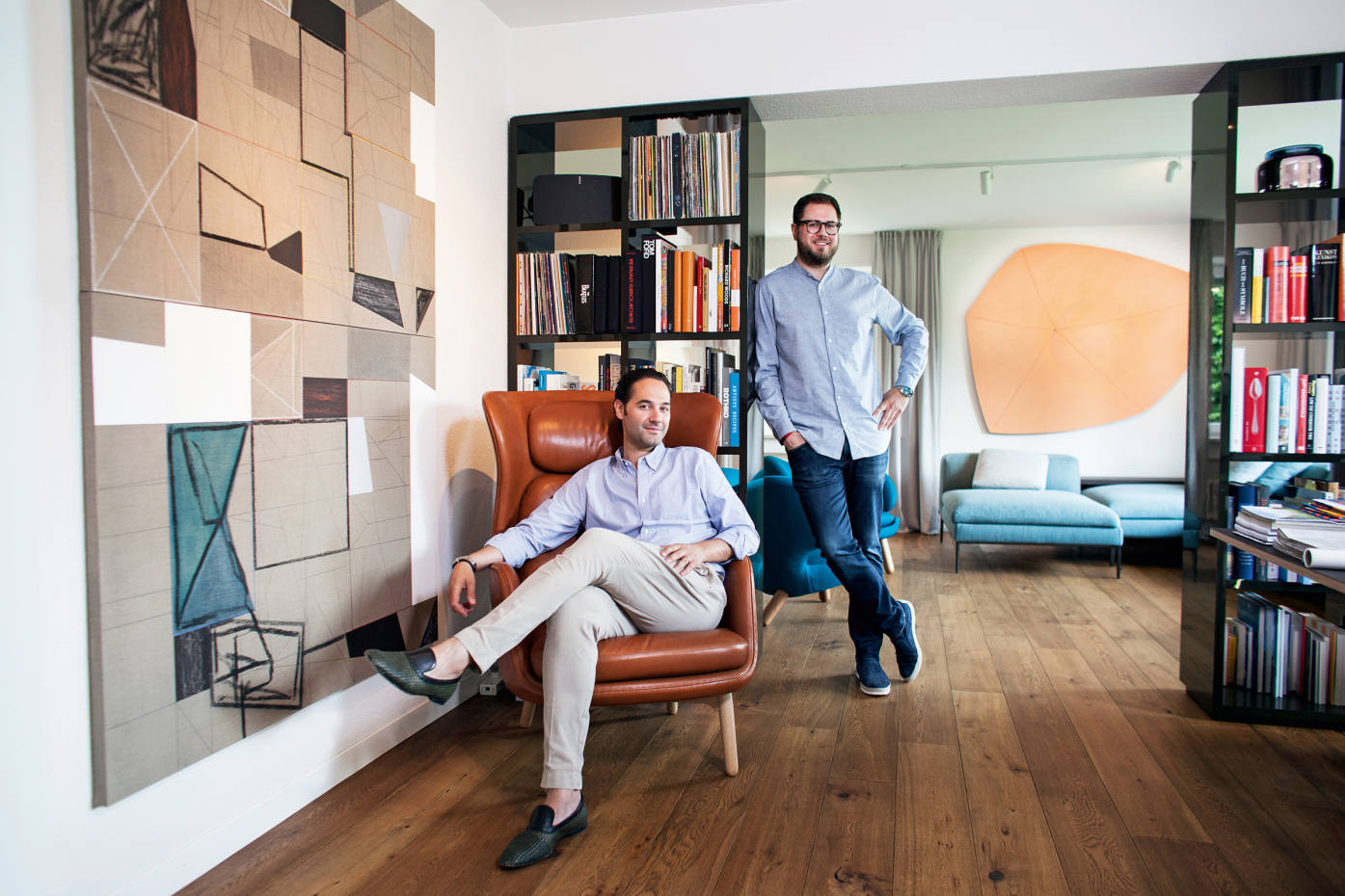 Leopold Weinberg (seated) and Stefan von Bartha at Weinberg's home in Zurich. From front: Variant t-s-(linen)-doubled by Andrew Bick, about £40,000, and Terra 2017 by Imi Knoebel, similar from about £150,000