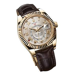 Rolex Sky-Dweller watch in yellow gold on alligator strap, £25,400. Also in other materials