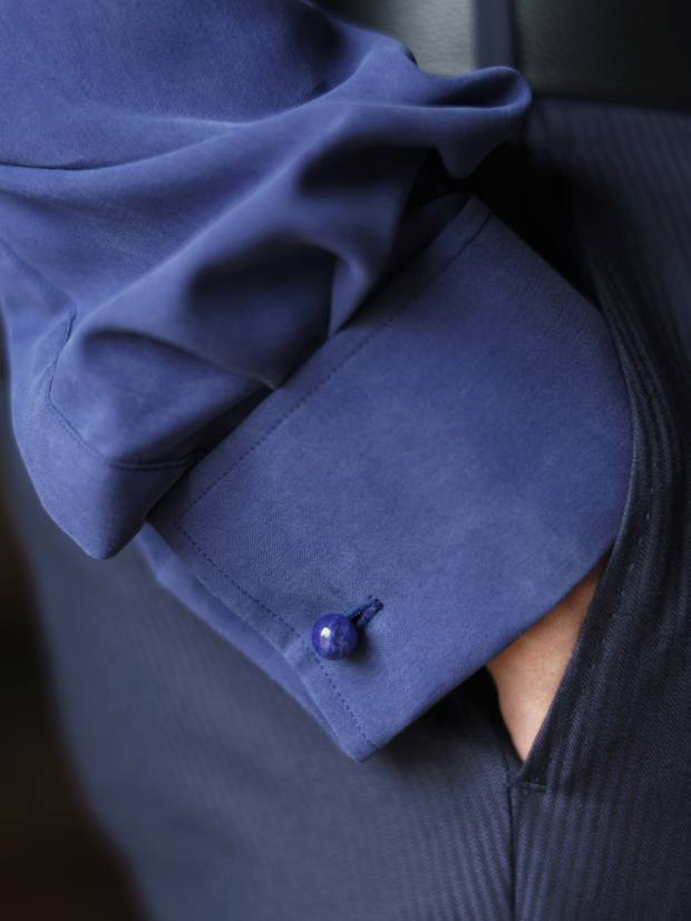 The tailored-fit pleated-front dress shirts come in a navy colourway, pictured, or cream