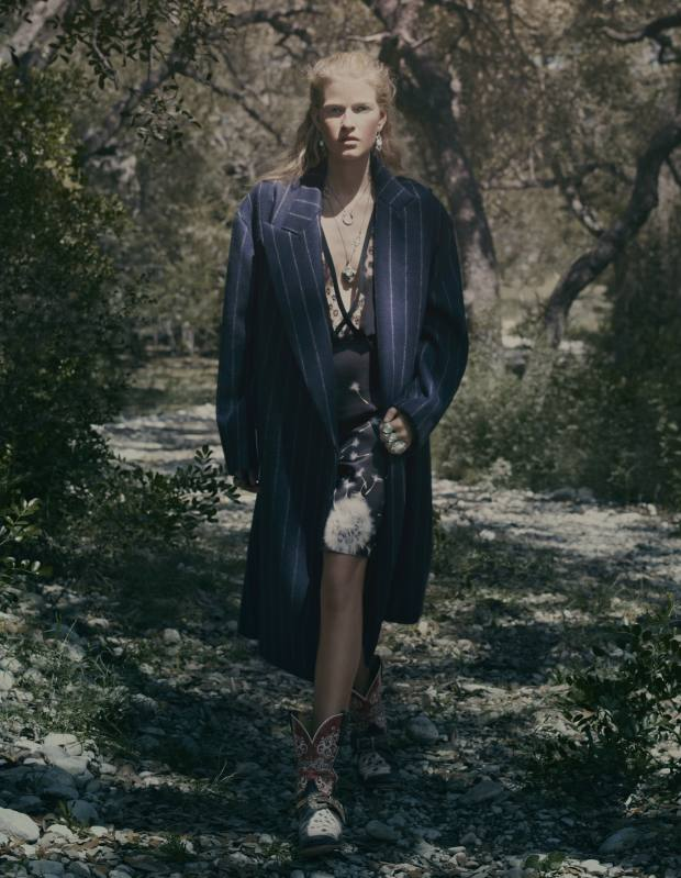 Wool coat, £2,255, by Stella McCartney. Silk and lace dress, £1,200, by Thakoon. Cowboy boots, stylist's own. Platinum-plated earrings with turquoise, diamonds and sapphires, £1,680, platinum-plated horseshoe necklace, £1,990, platinum-plated cross necklace with turquoise and diamonds, £4,445, and platinum-plated rings with turquoise, diamonds, tourmalines and spinels, from £1,730, all by Armenta