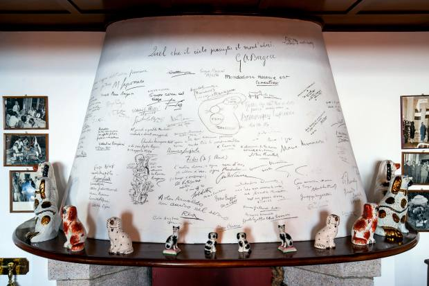 The chimneypiece at La Verbanella near Lake Maggiore, signed by visitors such as Ernest Hemingway and Thomas Mann