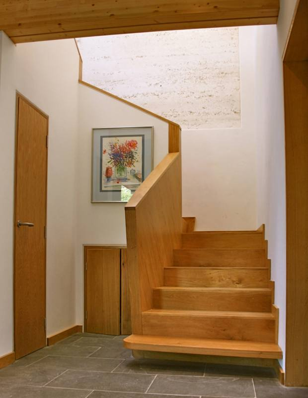 An exposed chalk panel above the stairs, in Barefoot Architecture's rammed-chalk house in Dorchester
