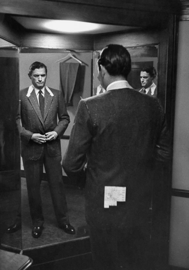 Gregory Peck having a fitting for his role in The Man in the Gray Flannel Suit