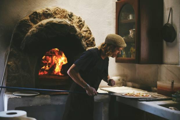 Chef Boris Buono cooks his pizzas in a wood-fired oven