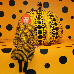 Yayoi Kusama with one of her Pumpkin pieces