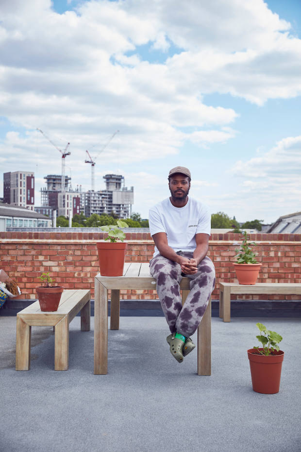 Multidisciplinary artist Yinka Ilori on the roof of his studio. He chose pot plants as his meaningful objects