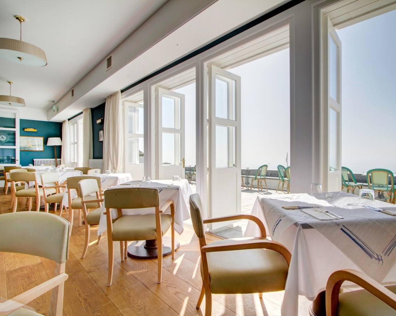 The Seaside Boarding House's restaurant and terrace possess a relaxed yet elegant atmosphere