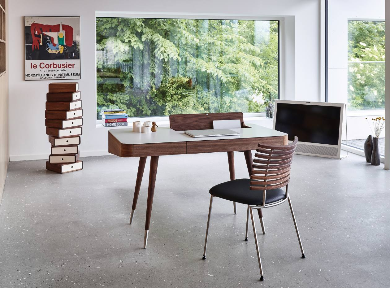 The Danish Retro desk shown in walnut has a Corian top and is also available in ash and oak