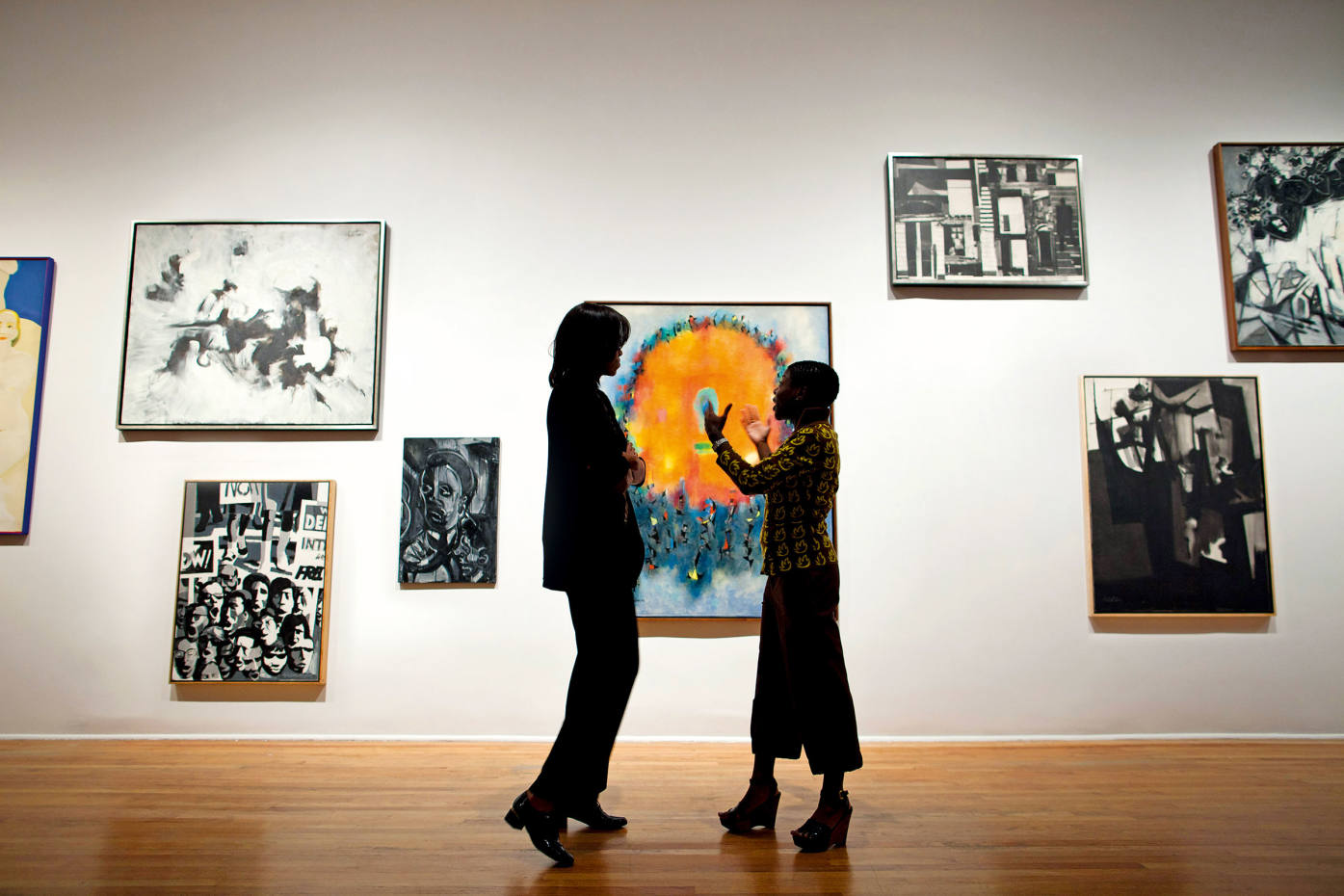 Michelle Obama is given atour of the Studio Museum in Harlem, which is devoted to artists of African descent, by its director Thelma Golden