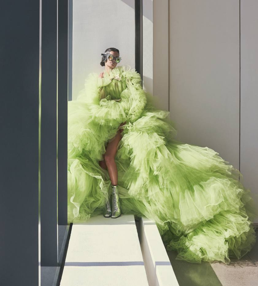 """Giambattista Valli Couture silk tulle gown, price on request. Calvin Klein 205W39NYC leather ankle boots with """"205"""" silver toe plate, £907. Goggles, stylist's own"""