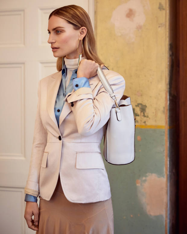 Tom Ford linen/silk jacket, £2,540, and silk Flounce skirt, £1,340. Bella Freud silk Little Prince shirt, £420. John Smedley merino-wool Catkin rollneck, £155. Andres Gallardo silk earrings, €242. Tod's leather bag, £1,450