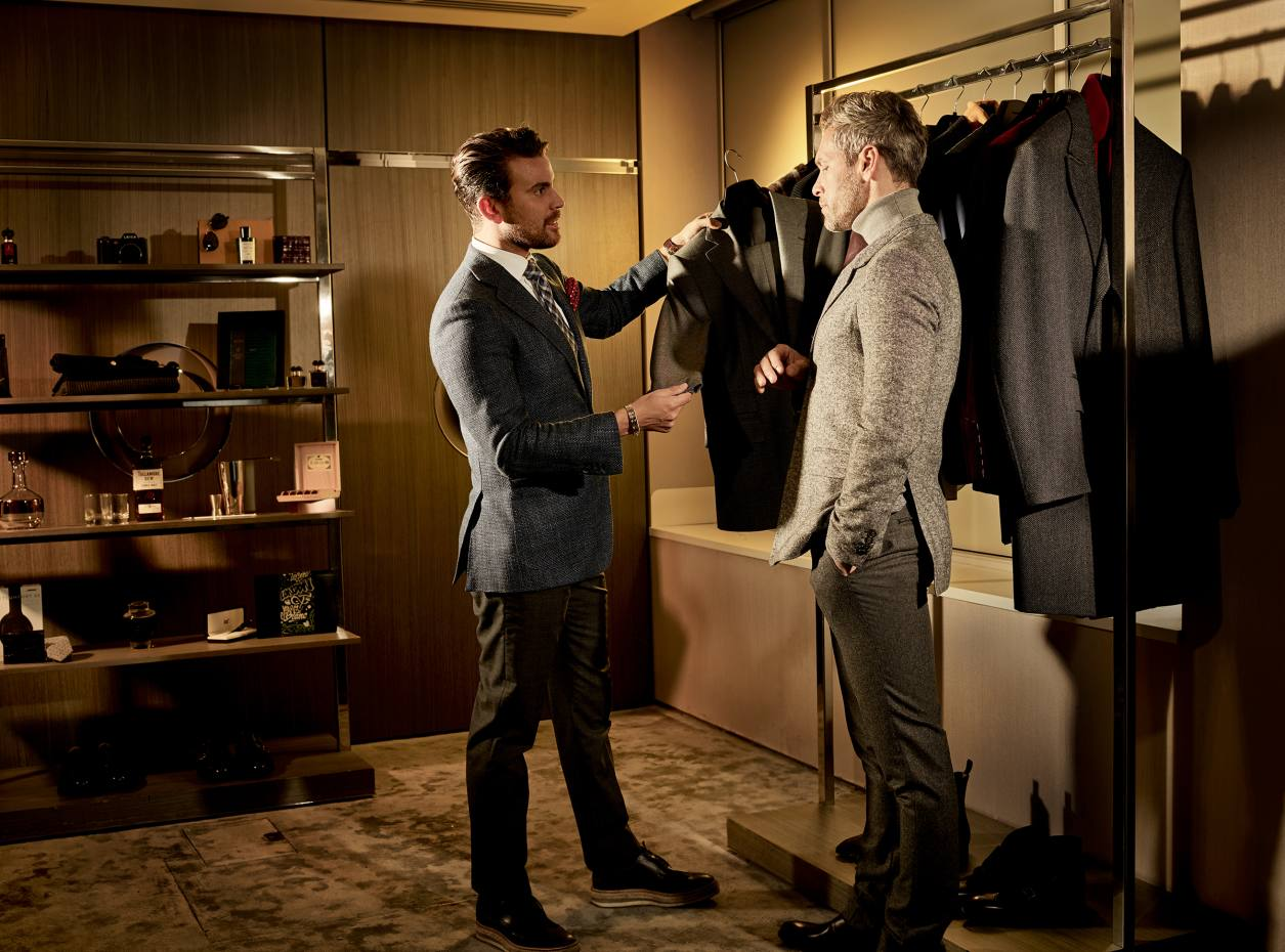 A Harrods Men's Adviser with a client in the store's personal-shopping suite