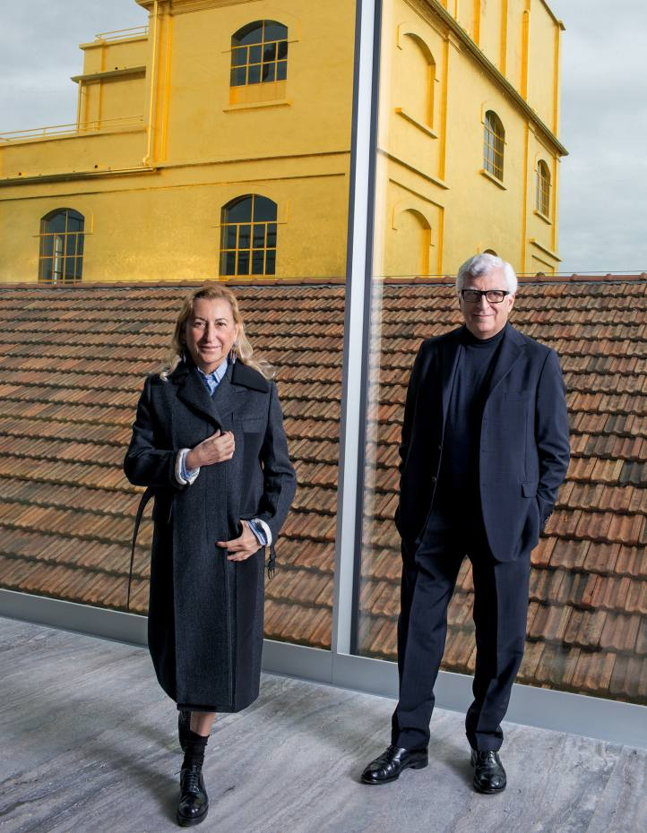 Prada chief executives Miuccia Prada and Patrizio Bertelli at Fondazione Prada, Milan, with the gold leaf covered Haunted House