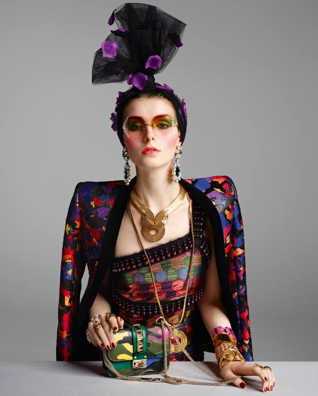 Balmain Lurex jacquard and velvet jacket, £2,600. Marco de Vincenzo Lurex and bead top, about £550, and matching skirt, about £595. Awon Golding Millinery tulle, net and silk turban, £240. Polaris vintage sunglasses, from £350, from The Eye Company. DSquared2 strass and turquoise crystal earrings, £280. Lara Bohinc gold plated Lunar Eclipse necklace, £690, gold plated Apollo pendant, £360, and gold plated Solar Eclipse bracelet (model's left arm bottom), £470. Mews London gold plate, Swarovski stone and crystal chain bracelet (right arm top), £300. Annelise Michelson gold plated double draped ring (right hand index finger), £195. Joomi Lim gold plated Dot Dash ring (right hand ring finger), £131. Valentino Garavani leather bag, £1,195. Cooee Design Plexiglas Baroque cuff, £32 (left arm top), and Plexiglas cuff (left arm second from top), £29. Kate Spade New York gold plated cuff (left arm third from top), £130. Kasun London gold plated Claw ring (left hand middle finger), £190. Rodney Rayner at Talisman Gallery gold and tsavorite ring (left hand ring finger), £3,975