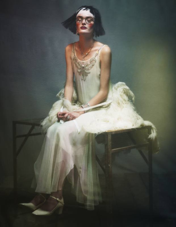Beaded chiffon Harrison dress, £8,230, and ostrich-plume Abigail cape, £2,850, both by Ralph Lauren Collection. Glazed leather Mary Jane shoes, £255, by Repetto. Vintage circa-1910 glasses in nickel, £275, by The Eye Company. Platinum and diamond Musk earrings, and platinum Moorea necklace with diamonds and pearls, both price on request by Cartier. Titanium and diamond cuff bracelet, £125,140, by Chopard. Vintage circa-1930 platinum and diamond ring, £78,000, from Sandra Cronan. Cartier, 175-177 New Bond Street, London W1 (020-3147 4850; www.cartier.com). Chopard, 12 New Bond Street, London W1 (020-7409 3140; www.chopard.com) and stockists. The Eye Company, 159 Wardour Street, London W1 (020-7434 0988; www.eye-company.co.uk). Ralph Lauren, 1 New Bond Street, London W1 (020-7535 4600; www.ralphlauren.com) and branches/stockists. Repetto, www.repetto.com and see Selfridges. Sandra Cronan, 1st Floor, 16 Albemarle Street, London W1 (020-7491 4851). Selfridges, 400 Oxford Street, London W1 (020-7318 2316; www.selfridges.com).