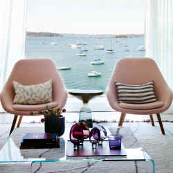 The chic living room of The Billyard in Sydney overlooks Elizabeth Bay