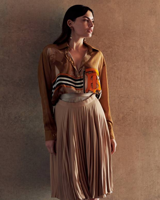 Burberry crepe de Chine shirt, £1,090, silk double‑waist skirt, £1,150, and gold-plated earrings, price on request
