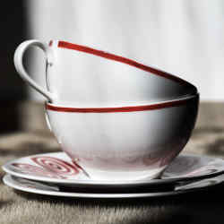Themis Z's new range of handmade crockery is decorated with striking red concentric circles