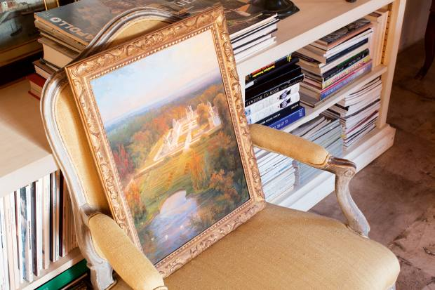 A Louis XV chair with a painting of the manor