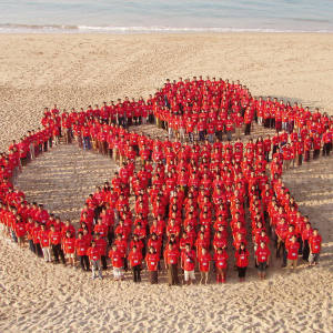 "Supporters gather in Myanmar to make up a human Save the Children ""Charlie Brown"" logo in 2008"