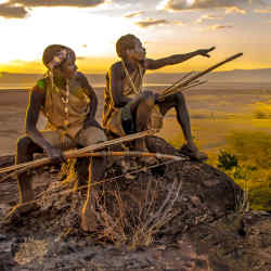 Hunters from theHadza tribe in Tanzania at sunset, 2007, photographed by Angela Fisher and Carol Beckwith for their new book, African Twilight
